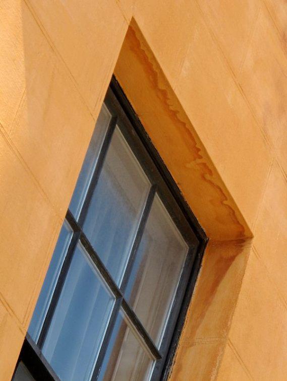 blue window in orange wall Bristol