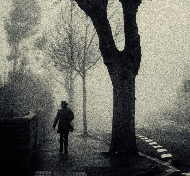 Woman in the fog, on the Wells Road, Bristol