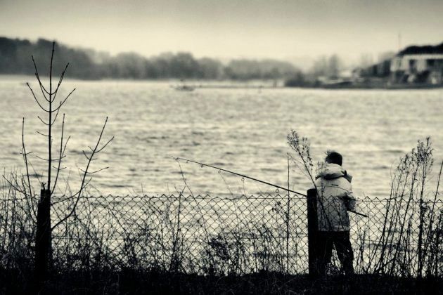 boy-fishing-on-a-stormy-day-mono