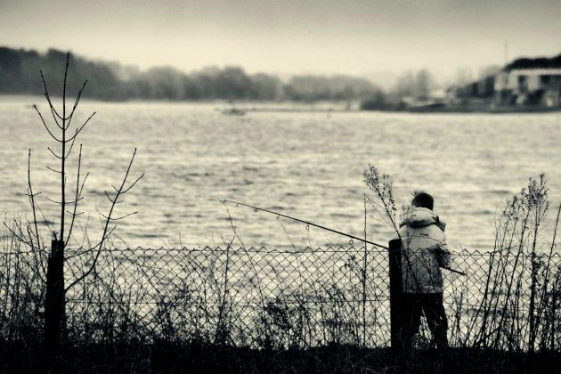 boy-fishing-on-a-stormy-day-mono