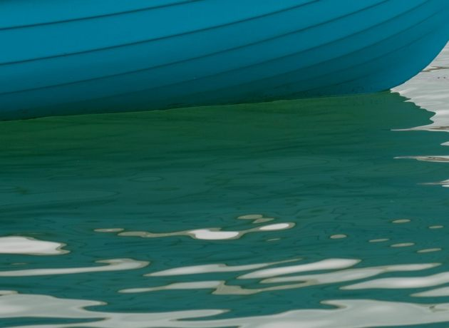 the-colour-of-the-sea-beneath-a-small-boat