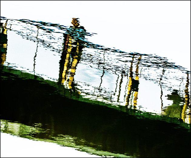 man-on-footbridge