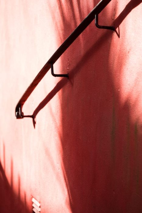 handrail-on-red-wall-overexposed