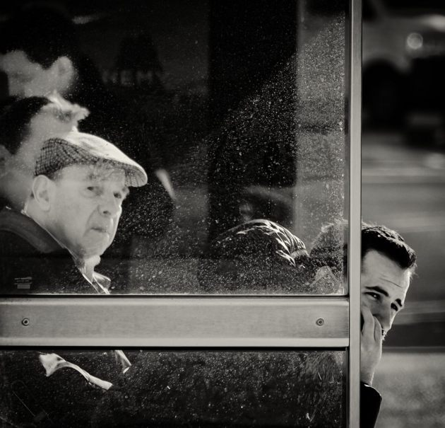 men-in-a-bus-shelter-mono